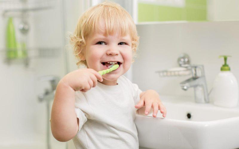 http://www.dreamstime.com/stock-photo-happy-kid-brushing-teeth-bathroom-bath-image33736330